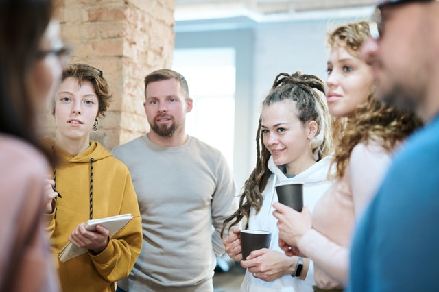 photo-of-people-standing-while-discussing-3182772